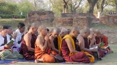 Monks praing at monastery ruins around Dhamekh Stupa,Sarnath,India Stock Footage