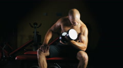 Athlete lifting heavy dumbbells in the gym. Stock Footage