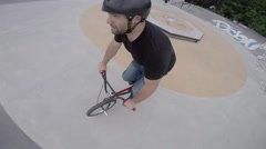 Extreme BMX Bicycle Riding peg stall to backwards  Stock Footage