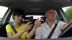Couple Smiling In Car Playing Pokemon Go With Smartphone Stock Footage