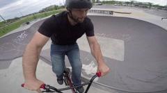 Extreme BMX Bicycle Riding - wheelie around skatepark bowl Stock Footage