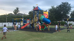 Children playing on public playground - stock footage