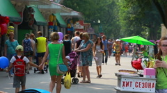 Urban park, crowd of people walking enjoying weekend (Editorial) Stock Footage