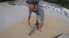 Extreme BMX Bicycle Riding in Concrete Skateboard Park Stock Footage