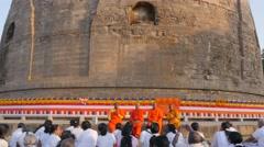Buddhist monks teach pilgrims at Dhamekh Stupa,Sarnath,India Stock Footage