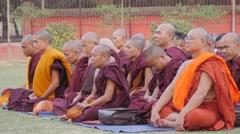 Buddhist monks  meditating at Dhamekh Stupa,Sarnath,India Stock Footage
