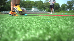 Soccer athlete training with a coach - stock footage