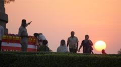Pilgrims walking around Dhamekh Stupa at sunset,Sarnath,India Stock Footage
