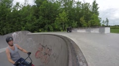 Peg Stall - Extreme BMX Bicycle Riding in Concrete Skateboard Park Stock Footage