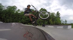 Extreme BMX Bicycle Riding in Concrete Skateboard Park - Bar spin to tire tap Stock Footage