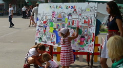 Urban park, children drawing on the board (Editorial). Stock Footage