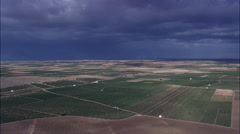 Field Patterns With Storm Clouds Ahead Stock Footage