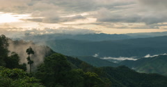 Cloud and foggy float over forest mountain in sunrise. Stock Footage