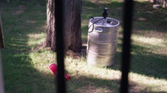 The Morning After the Party - Keg and Beer cups through fence Stock Footage