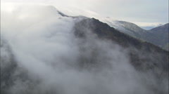Clouds Spilling Over Mountains Stock Footage