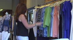Woman in a store looking for a bargain - stock footage
