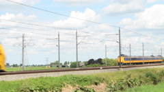 Dutch Railways trains passing Stock Footage