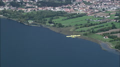 Small Plane Over Lake Iseo Stock Footage