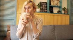 Woman Drinking Coffee Latte in a Coffee Shop Stock Footage