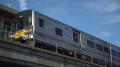 Train pulls out of the station during morning commute - stock footage