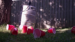 The Morning After the Back Yard Party - Keg and Beer cups Stock Footage