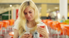 Woman Using Cell Phone at a Shopping Center Stock Footage