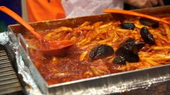 Red spicy rice cake, korean food. korean pasta with chilli sauce Tteokbokki Stock Footage