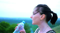 Woman drink water after sport - stock footage