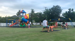 Children playing on public playground Stock Footage