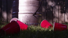 Slow motion beer spilling - red cup and a keg party - stock footage