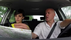Lost Man And Woman In Car Using Map For Directions Stock Footage