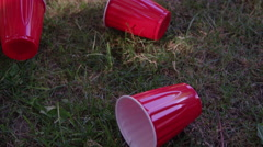 The Morning After the Party - Keg and Beer cups - tilt up to reveal - stock footage