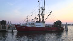 Fishing boat docked during Sunset Stock Footage