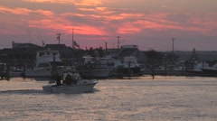 Small boat passing through Galilee, RI during sunset Stock Footage