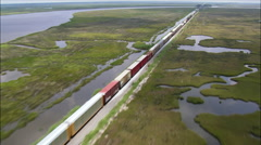 Freight Train Crossing Bridge On Pearl River Stock Footage