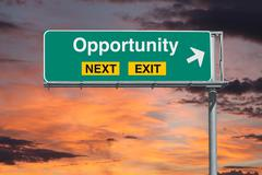 Opportunity Next Exit Freeway Sign with Sunrise Sky Stock Photos