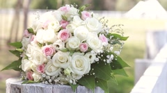 Wedding bouquet of roses lying on the fence Stock Footage