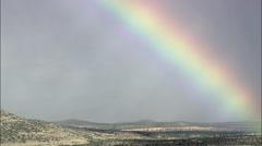 Spectacular Rainbow Over Bell Mountain Stock Footage