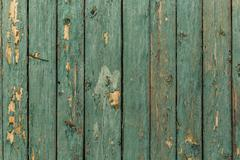 Old wood texture with peeling green paint Stock Photos