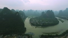 AERIAL SEQUENCE FLY OVER XING PING ON THE LI RIVER, CHINA Stock Footage