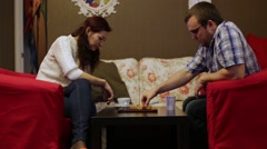 Man And Women Play A Board Game Stock Footage