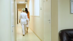 Nurse Patient in Corridor Of Clinic Stock Footage
