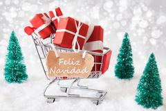 Trolly With Gifts And Snow, Feliz Navidad Means Merry Christmas Stock Photos