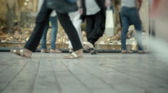4K women browsing storefront of shoe shop in commercial street low angle Stock Footage