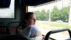 Mom holding baby on hands and rides the bus Stock Footage