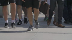 NEW YORK CITY FOOT TRAFFIC PEDESTRIANS SLOW MOTION SNEAKERS SHORTS Stock Footage