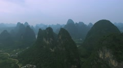 AERIAL TRACKING SHOT OF KARST PEAKS OVER LI RIVER IN GUILIN CHINA Stock Footage