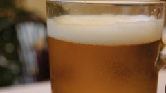 Close up of a beer glass put on a table Stock Footage