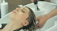 Young girl in a barbershop Stock Footage
