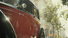 Classic restored luxury car parked on city shopping disctict - stock footage
